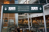 A welcome sign is displayed at the Vancouver International Airport in Vancouver British Columbia Canada on Saturday Nov 12 2011 Vancouver a coastal...