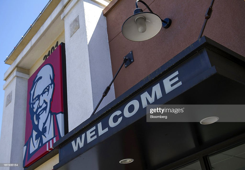 A 'Welcome' sign is displayed outside of a Yum! Brands Inc. Kentucky Fried Chicken restaurant in San Francisco, California, U.S., on Tuesday, April 23, 2013. Yum! Brands Inc., owner of the KFC and Pizza Hut dining chains, posted first-quarter profit that topped analysts' estimates as new menu items helped Taco Bell's domestic sales. Photographer: David Paul Morris/Bloomberg via Getty Images