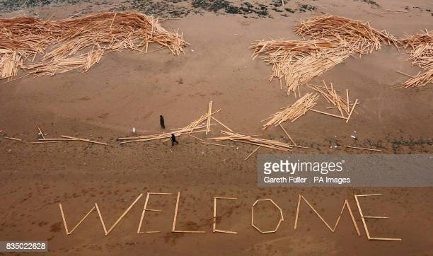 A welcome sign made from timber washed up on a beach in Ramsgate Kent