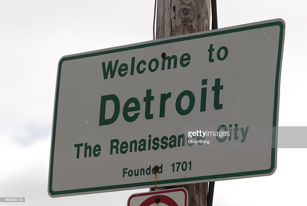 A 'Welcome to Detroit' sign is displayed on Dequindre Road in Detroit, Michigan, U.S., on Thursday, Feb. 21, 2013. A fiscal emergency grips Detroit, according to a report ordered by Governor Rick Snyder, that opens a path to a state takeover of General Motors Co.'s home town, citing deficits that have stymied city officials after a $326.6 million gap last year. Photographer: Jeff Kowalsky/Bloomberg via Getty Images