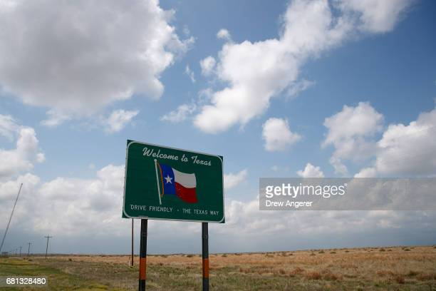 A 'Welcome to Texas' sign stands on the side of the road May 9 2017 near Dalhart Texas Tuesday was the group's second day in the field for the 2017...