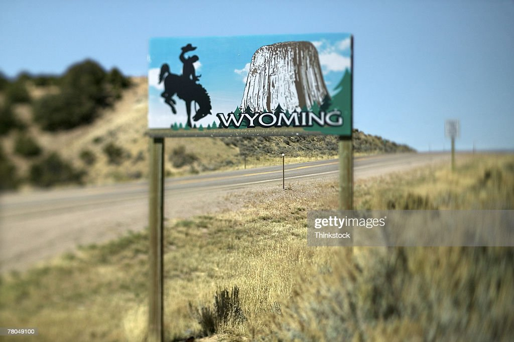 Welcome to Wyoming sign on hill