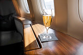 A Glass of Welcoming Champagne awaits a First Class passenger on an Airline Flight