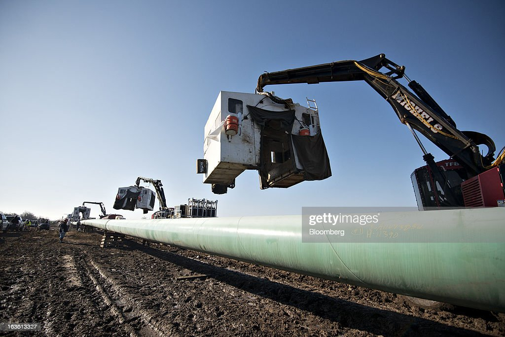 A weld shack is moved toward a pipe joint during construction of the Gulf Coast Project pipeline in Atoka, Oklahoma, U.S., on Monday, March 11, 2013. The Gulf Coast Project, a 485-mile crude oil pipeline being constructed by TransCanada Corp., is part of the Keystone XL Pipeline Project and will run from Cushing, Oklahoma to Nederland, Texas. Photographer: Daniel Acker/Bloomberg via Getty Images