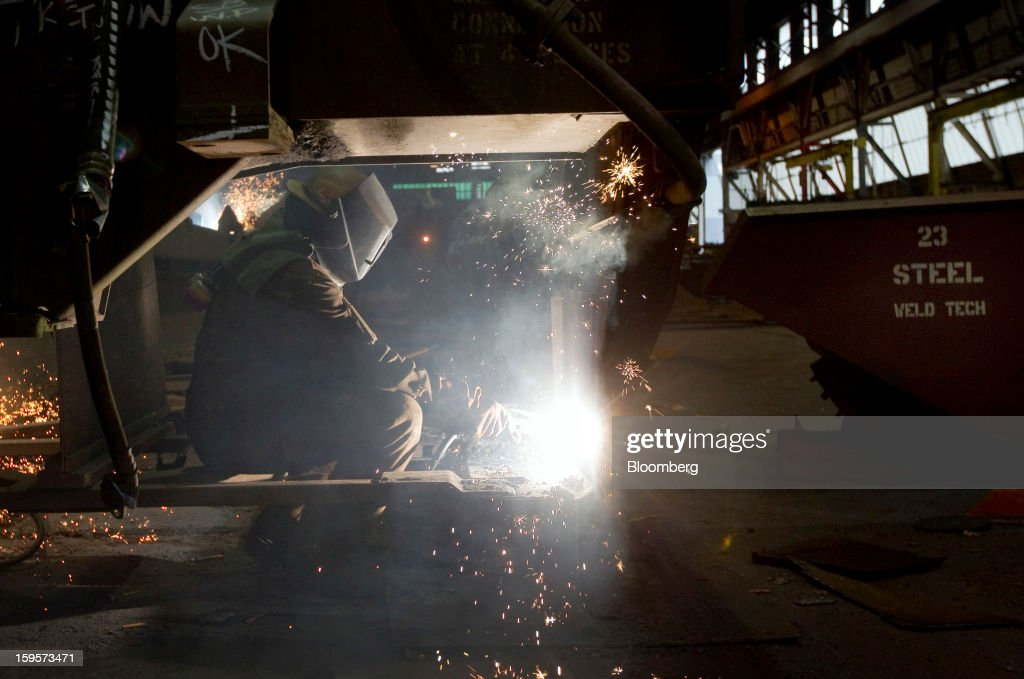 A welder builds a refrigerated railcar at the Greenbrier Cos.' Gunderson railcar plant in Portland, Oregon, U.S., on Tuesday, Jan. 15, 2013. Industrial production in the U.S. climbed for a second month in December as demand picked up for capital equipment, showing factories strengthened entering 2013. Photographer: Natalie Behring/Bloomberg via Getty Images