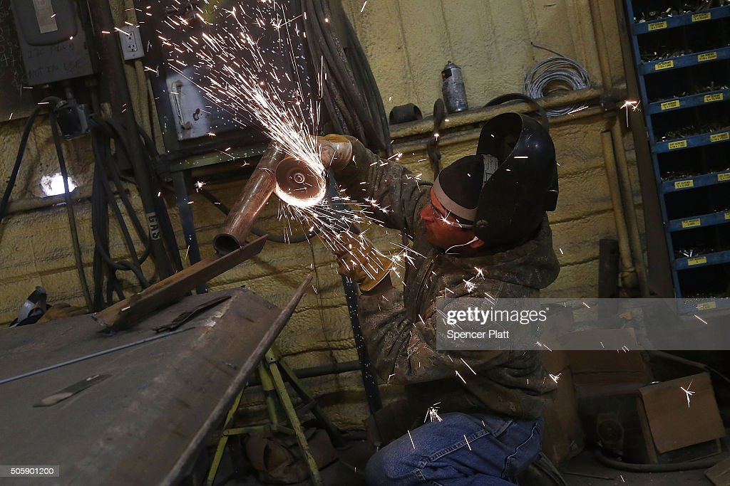 A welder for Stewarts Inc an oilfield service company works on a pipe that will be used in the fracking industry in the Permian Basin oil field on...