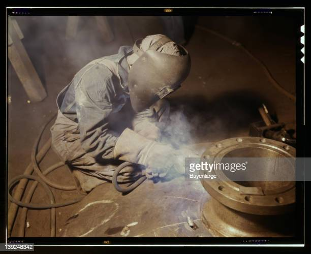 Welder making boilers for a ship Combustion Engineering Co Chattanooga Tennessee 1942