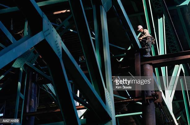 Welder Repairing a Bridge