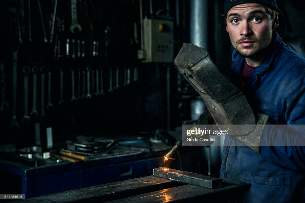 Welder soldering iron in workshop