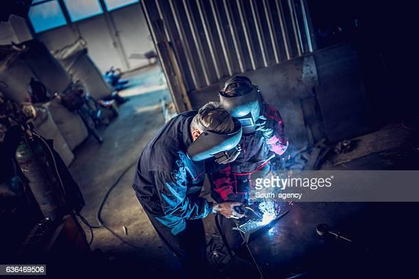 Welder team in workshop