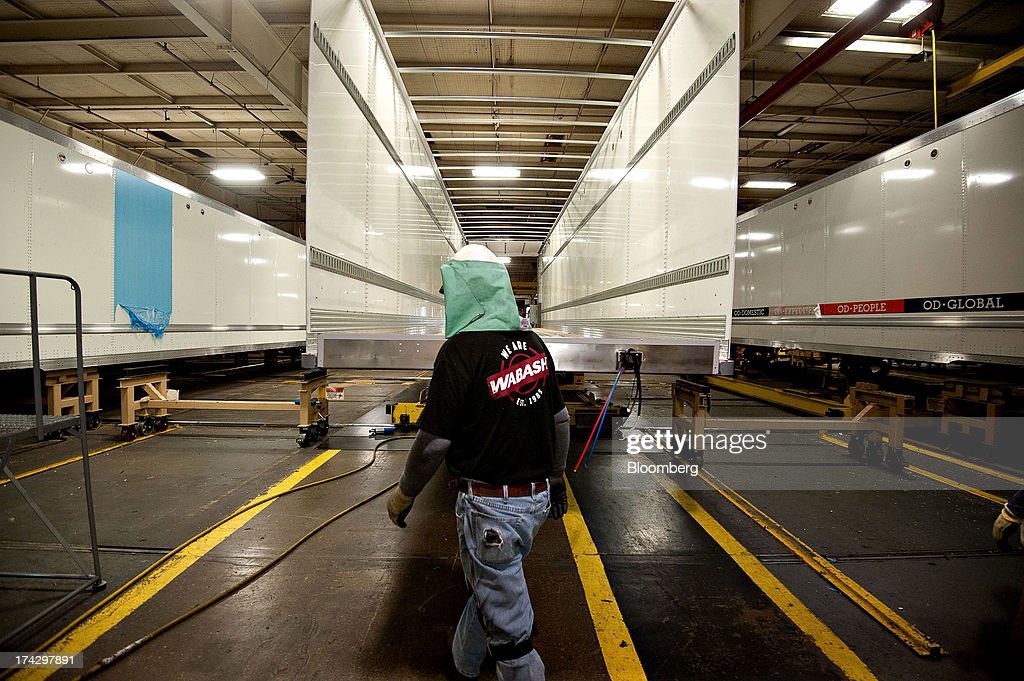 A welder walks past a partially constructed semi trailer at the Wabash National Corp. facility in Lafayette, Indiana, U.S., on Monday, July 22, 2013. Wabash National Corp. is scheduled to release earnings figures on July 30. Photographer: Daniel Acker/Bloomberg via Getty Images