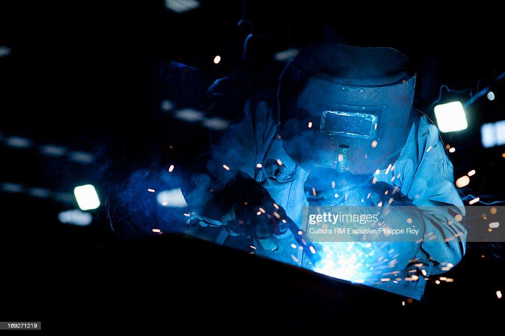 Welder working in hydraulics factory