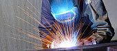 welder works in an industrial company - production of steel components