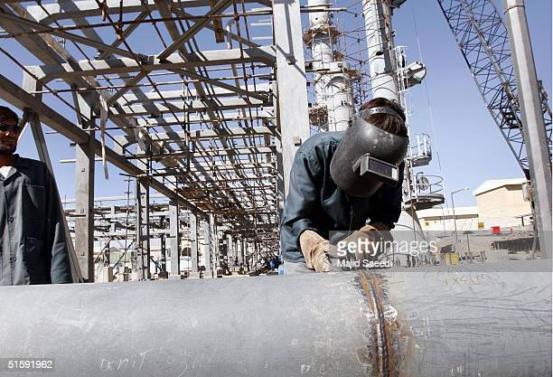 A welder works on a section of Iran's controversial heavy water production facility October 27 2004 at Arak south of the Iranian capital Tehran Iran...