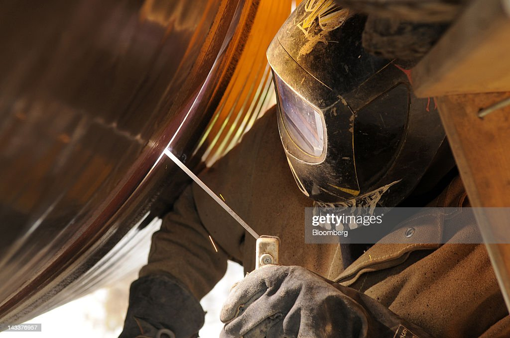 A welder works on a section of the Gazelle gas pipeline, operated by Net4Gas, during construction outside Chomutov, Czech Republic, on Wednesday, April 25, 2012. RWE AG has about 20 potential buyers for its Net4Gas unit, which operates the Czech gas pipeline network, Lidove Noviny reported without citing anyone. Photographer: Vladimir Weiss/Bloomberg via Getty Images