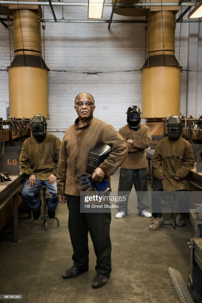 Welders posing in foundry