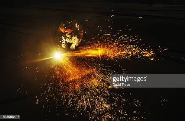 Welders working at a ship building yard in China.