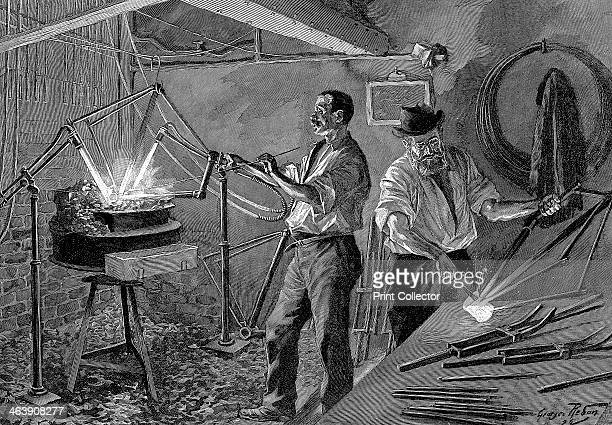 Welding a bicycle frame France 1896 The frame is suspended over a forge as a worker applies a welding rod
