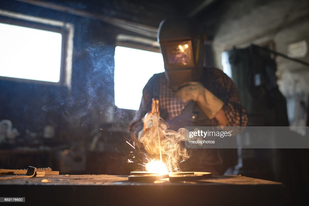 Welding in smithy : Stock Photo