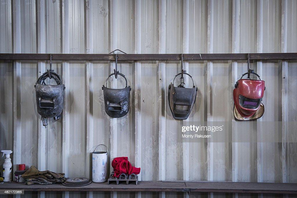 Welding masks in engineering workshop