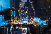Automatic welding robots movement in a car factory