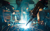 Welding robots movement in a car factory, automotive parts industry