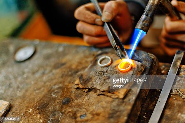 Welding torch melting the silver rings