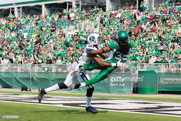 Weldon Brown of the Saskatchewan Roughriders breaks up a pass intended for Tori Gurley of the Toronto Argonauts in the end zone in the game between...