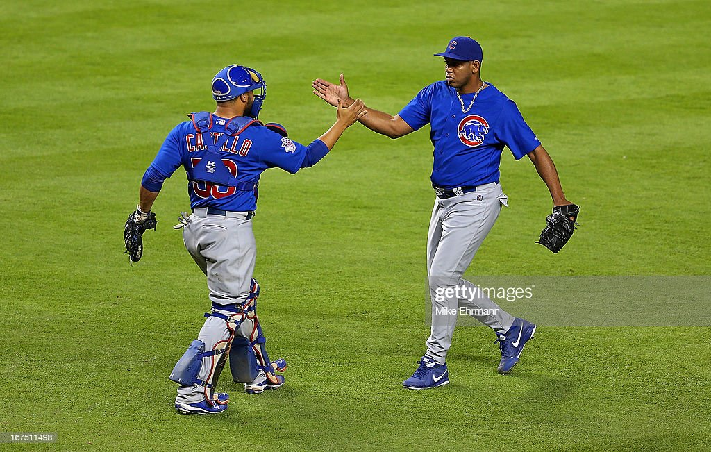 Welington Castillo #53 and Carlos Marmol #49 of the Chicago Cubs celebratre after winning a game against the Miami Marlins at Marlins Park on April 25, 2013 in Miami, Florida.