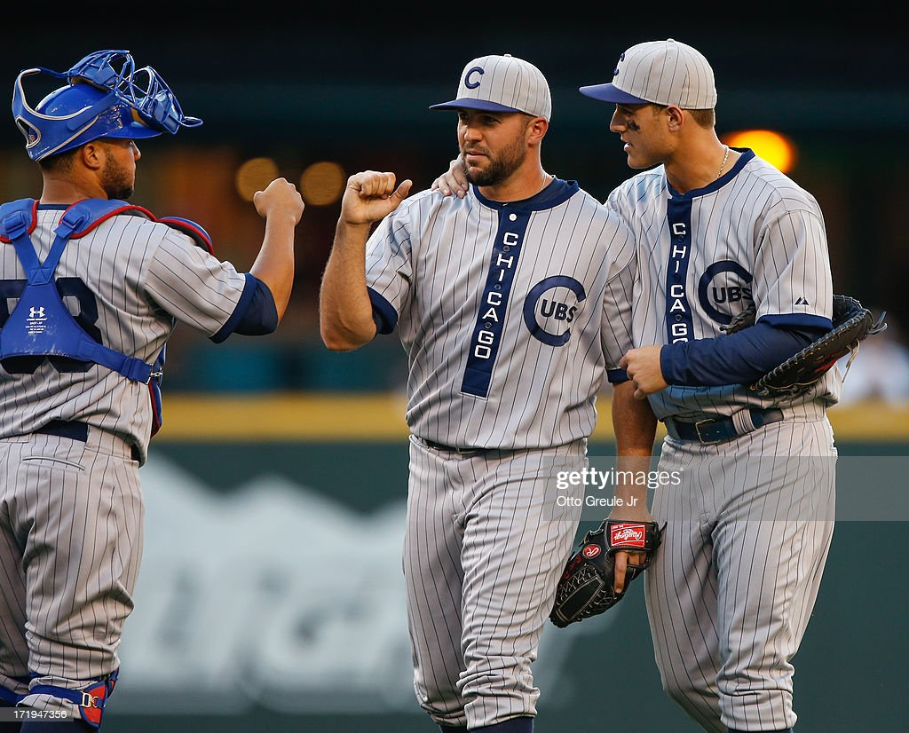 Welington Castillo #53, Blake Parker #50, and Anthony Rizzo #44 of the Chicago Cubs celebrate after defeating the Seattle Mariners 5-3 in eleven innings at Safeco Field on June 29, 2013 in Seattle, Washington.