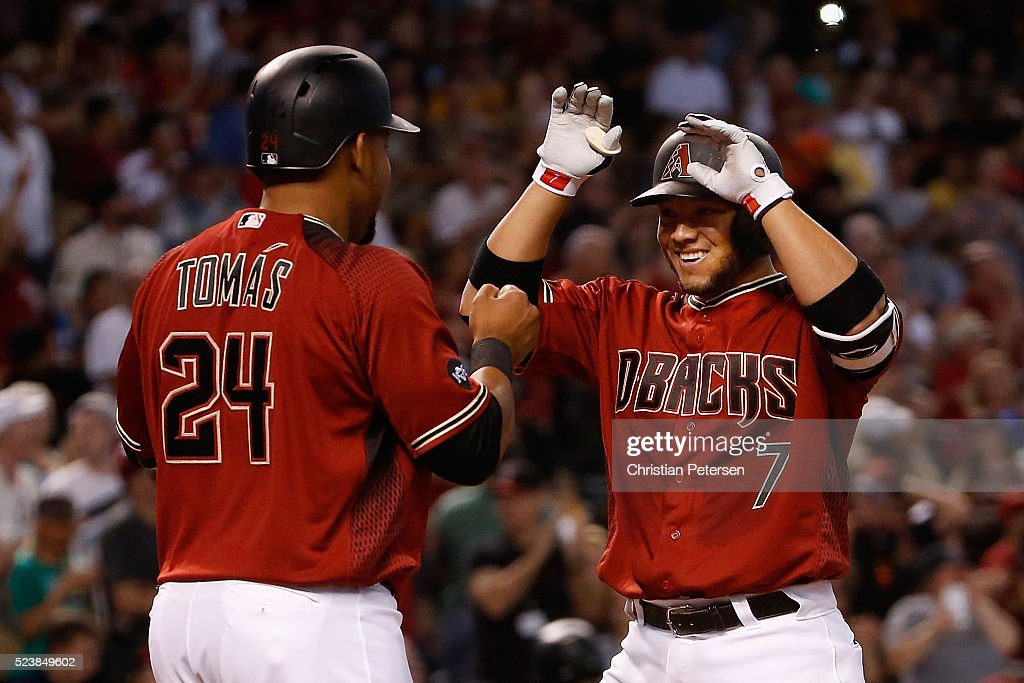 <a gi-track='captionPersonalityLinkClicked' href=/galleries/search?phrase=Welington+Castillo&family=editorial&specificpeople=4959193 ng-click='$event.stopPropagation()'>Welington Castillo</a> #7 of the Arizona Diamondbacks high-fives Yasmany Tomas #24 after Castillo hit a three-run home run against the Pittsburgh Pirates during the third inning of the MLB game at Chase Field on April 24, 2016 in Phoenix, Arizona.