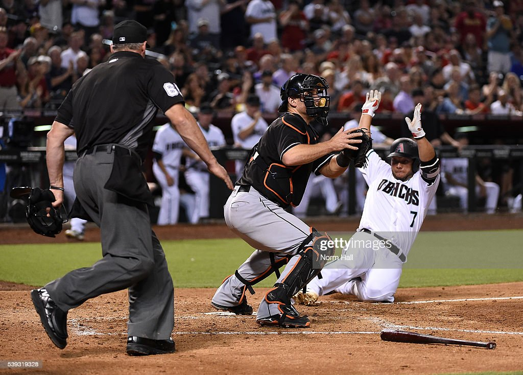 <a gi-track='captionPersonalityLinkClicked' href=/galleries/search?phrase=Welington+Castillo&family=editorial&specificpeople=4959193 ng-click='$event.stopPropagation()'>Welington Castillo</a> #7 of the Arizona Diamondbacks safely slides into home on a double by teammate Jake Lamb #22 during the fifth inning as catcher <a gi-track='captionPersonalityLinkClicked' href=/galleries/search?phrase=Jeff+Mathis&family=editorial&specificpeople=660661 ng-click='$event.stopPropagation()'>Jeff Mathis</a> #6 of the Miami Marlins waits for the throw at Chase Field on June 10, 2016 in Phoenix, Arizona.