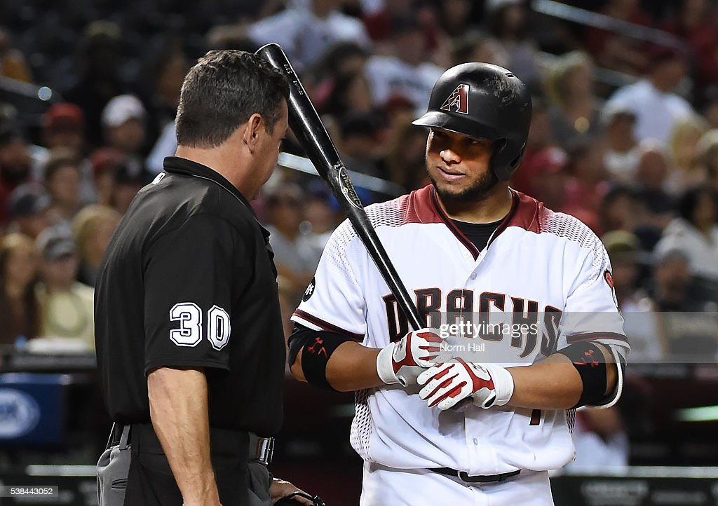 Welington Castillo of the Arizona Diamondbacks talks with home plate umpire Rob Drake after being called out on strikes during the third inning...