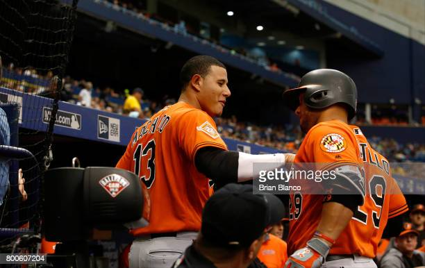 Welington Castillo of the Baltimore Orioles celebrates his tworun home run with teammate Manny Machado during the second inning of a game against the...