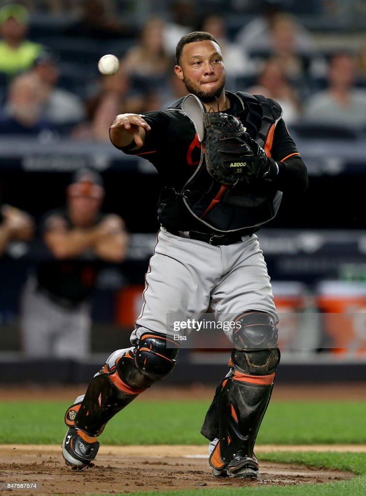 Welington Castillo #29 of the Baltimore Orioles fields a hit by Starlin Castro of the New York Yankees and sends it to first for the out in the fifth inning on September 15, 2017 at Yankee Stadium in the Bronx borough of New York City.