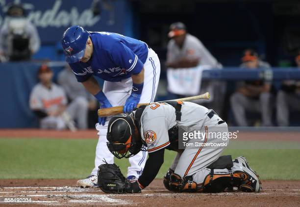 Welington Castillo of the Baltimore Orioles goes down after taking a foul tip in the first inning during MLB game action as Miguel Montero of the...