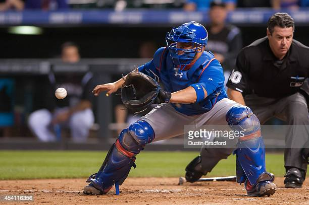 Welington Castillo of the Chicago Cubs awaits the ball at home plate but is late with a tag attempt as a runner scores in the sixth inning during a...