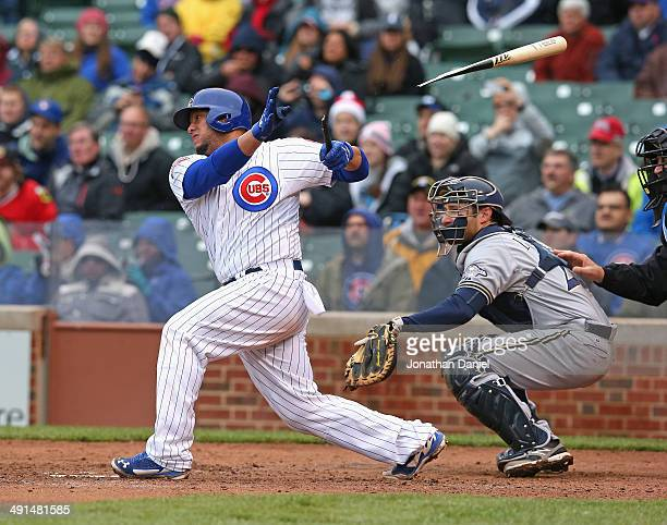 Welington Castillo of the Chicago Cubs breaks his bat hitting against the Milwaukee Brewers at Wrigley Field on May 16 2014 in Chicago Illinois The...