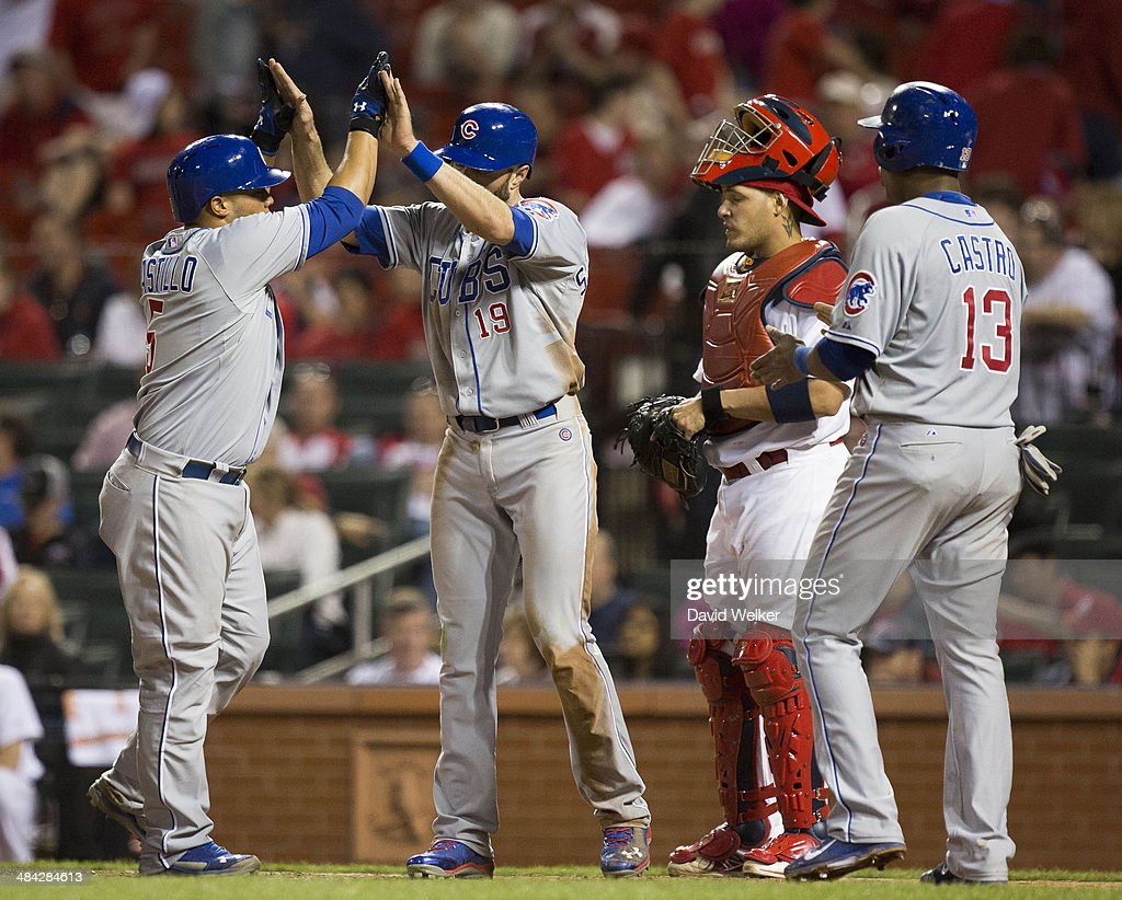 <a gi-track='captionPersonalityLinkClicked' href=/galleries/search?phrase=Welington+Castillo&family=editorial&specificpeople=4959193 ng-click='$event.stopPropagation()'>Welington Castillo</a> #5 of the Chicago Cubs celebrates with <a gi-track='captionPersonalityLinkClicked' href=/galleries/search?phrase=Nate+Schierholtz&family=editorial&specificpeople=803208 ng-click='$event.stopPropagation()'>Nate Schierholtz</a> #19 and <a gi-track='captionPersonalityLinkClicked' href=/galleries/search?phrase=Starlin+Castro&family=editorial&specificpeople=5970945 ng-click='$event.stopPropagation()'>Starlin Castro</a> #13 at the plate after hitting a three run home run in the top of the eleventh inning during a game against the St. Louis Cardinals at Busch Stadium on April 11, 2014 in St. Louis, Missouri. The Cubs defeated the Cardinals 6-3 in eleven innings.