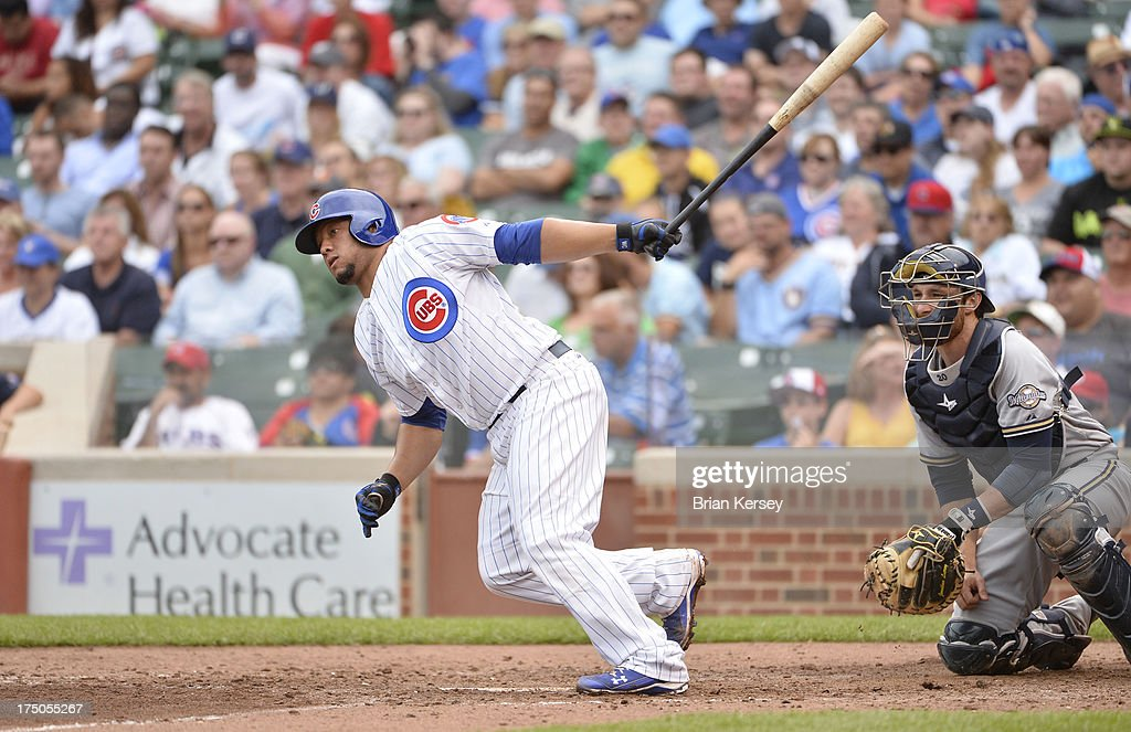 <a gi-track='captionPersonalityLinkClicked' href=/galleries/search?phrase=Welington+Castillo&family=editorial&specificpeople=4959193 ng-click='$event.stopPropagation()'>Welington Castillo</a> #53 of the Chicago Cubs follows through on an RBI single scoring teammate Luis Valbuena #24 as <a gi-track='captionPersonalityLinkClicked' href=/galleries/search?phrase=Jonathan+Lucroy&family=editorial&specificpeople=5732413 ng-click='$event.stopPropagation()'>Jonathan Lucroy</a> #20 of the Milwaukee Brewers watches the play during the fifth inning at Wrigley Field on July 30, 2013 in Chicago, Illinois.