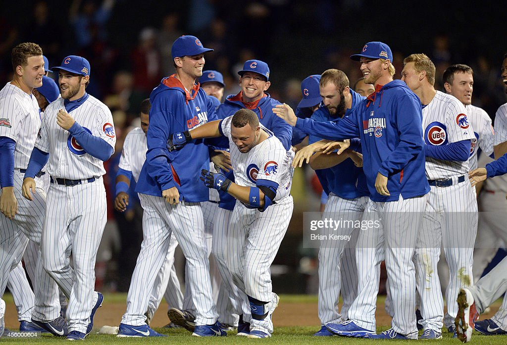 <a gi-track='captionPersonalityLinkClicked' href=/galleries/search?phrase=Welington+Castillo&family=editorial&specificpeople=4959193 ng-click='$event.stopPropagation()'>Welington Castillo</a> #5 of the Chicago Cubs (C) is mobbed by his teammates after hitting a game-winning RBI single scoring teammate Anthony Rizzo during the tenth inning against the St. Louis Cardinals at Wrigley Field on September 23, 2014 in Chicago, Illinois. The Cubs defeated the Cardinals 4-3 in 10 innings.