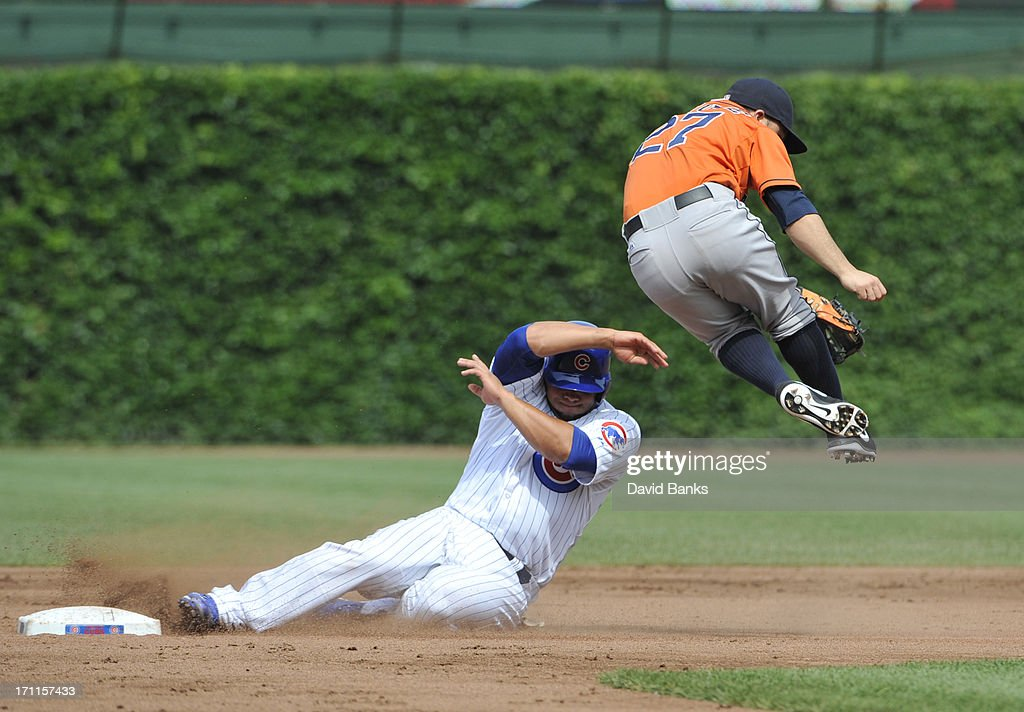 Welington Castillo #53 of the Chicago Cubs is safe at second base on a fielders choice as Jose Altuve #27 of the Houston Astros gets pulled off the base during the third inning on June 22, 2013 at Wrigley Field in Chicago, Illinois.
