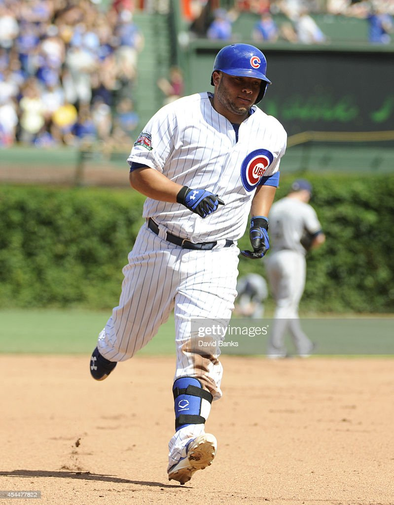 Welington Castillo #5 of the Chicago Cubs runs the bases after hitting a two-run homer against the Milwaukee Brewers during the fourth inning on September 1, 2014 at Wrigley Field in Chicago, Illinois.