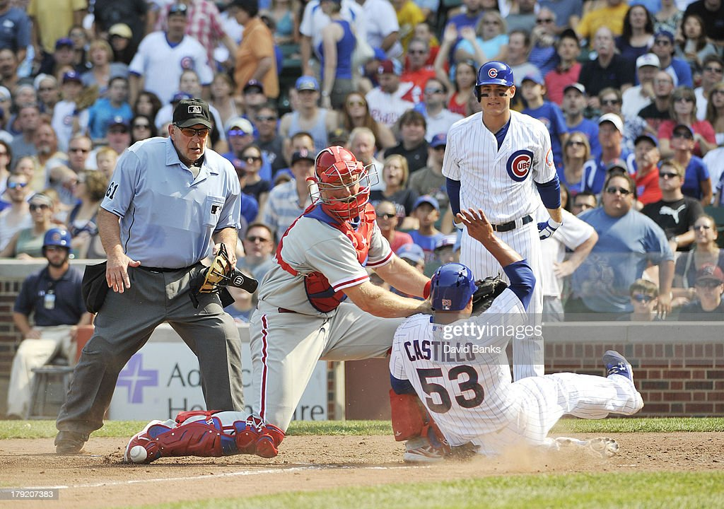 <a gi-track='captionPersonalityLinkClicked' href=/galleries/search?phrase=Welington+Castillo&family=editorial&specificpeople=4959193 ng-click='$event.stopPropagation()'>Welington Castillo</a> #53 of the Chicago Cubs slides safely into home as <a gi-track='captionPersonalityLinkClicked' href=/galleries/search?phrase=Erik+Kratz&family=editorial&specificpeople=809194 ng-click='$event.stopPropagation()'>Erik Kratz</a> #31 of the Philadelphia Phillies can't handle the throw during the fourth inning on September 1, 2013 at Wrigley Field in Chicago, Illinois.