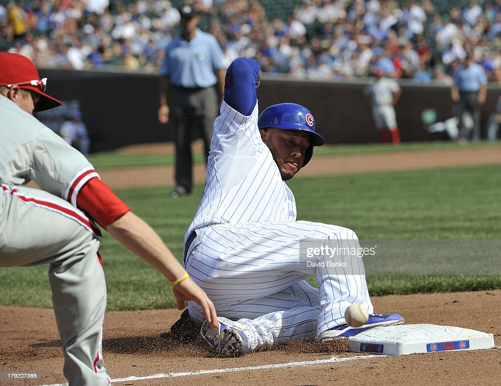 <a gi-track='captionPersonalityLinkClicked' href=/galleries/search?phrase=Welington+Castillo&family=editorial&specificpeople=4959193 ng-click='$event.stopPropagation()'>Welington Castillo</a> #53 of the Chicago Cubs slides safely into third base as Cody Asche #25 of the Philadelphia Phillies can't handle the throw during the fourth inning on September 1, 2013 at Wrigley Field in Chicago, Illinois.