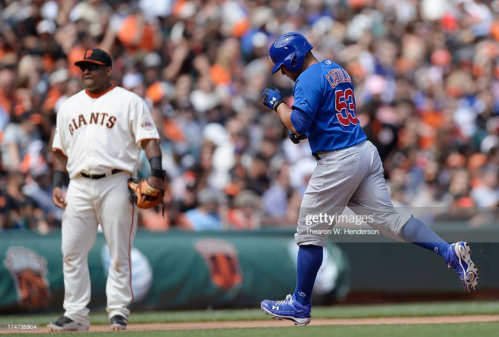 Welington Castillo #53 of the Chicago Cubs trots around the bases after hitting a solo home run as third baseman Pablo Sandoval #48 of the San Francisco Giants looks on in the seventh inning at AT&T Park on July 28, 2013 in San Francisco, California.