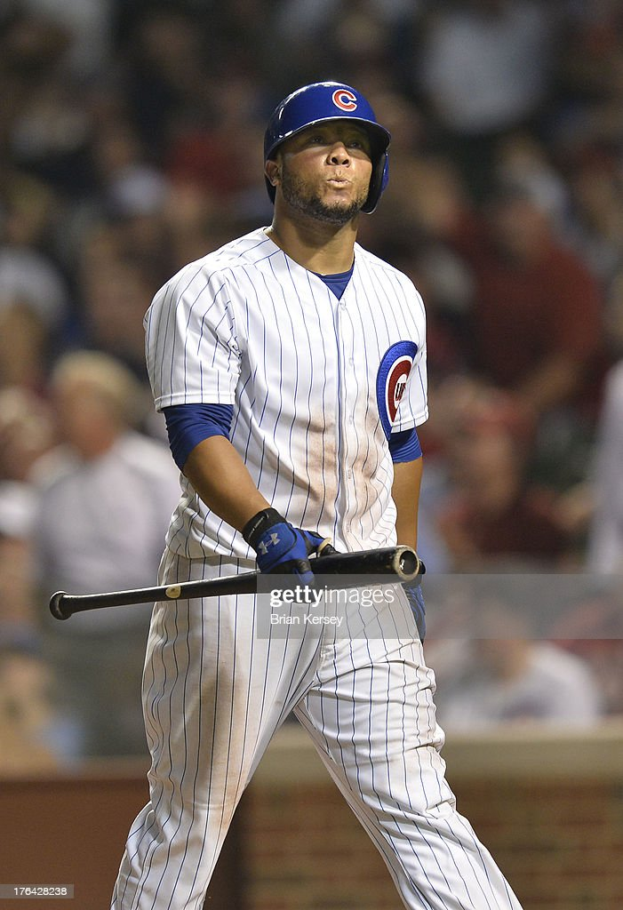 <a gi-track='captionPersonalityLinkClicked' href=/galleries/search?phrase=Welington+Castillo&family=editorial&specificpeople=4959193 ng-click='$event.stopPropagation()'>Welington Castillo</a> #53 of the Chicago Cubs walks back to the dugout after striking out to end the sixth inning against the Cincinnati Reds at Wrigley Field on August 12, 2013 in Chicago, Illinois.