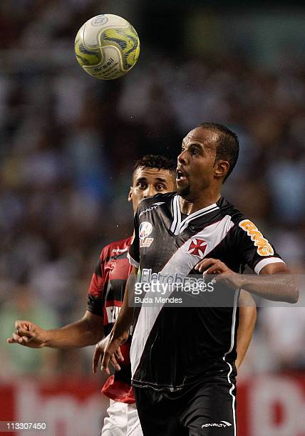 Welington of Flamengo struggles for the ball with Alecsandro of Vasco during a match as part of Rio de Janeiro State Championship 2011 at Engenhao...