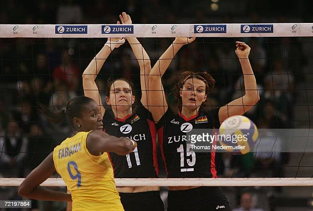Welissa Gonzaga of Brazil Cathrin Schlueter and Angelina Gruen of Germany in action during the friendly volleyball game between Germany and Brazil at...