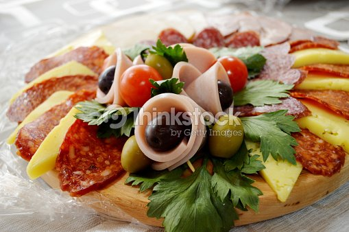 Well decorated food canapes coldcuts buffet stock photo for Canape buffet menus